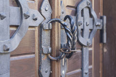 Steel handles on ancient wooden gate. Of church stock images