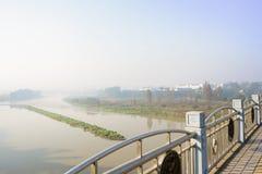 Steel handrail of highway bridge in sunny foggy winter morning Royalty Free Stock Image