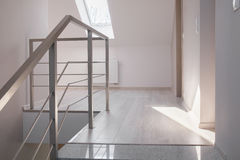Steel handrail and marble stairs Royalty Free Stock Images