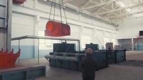 Steel Hardening ingot in the workspace, Big red-hot metal detail from metal furnace on crane