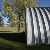 Steel hay storage building. Royalty Free Stock Photo