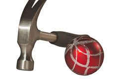 A red ball and a hammer. Royalty Free Stock Photography