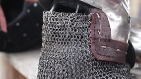 Steel helmet with chain mail face mask, medieval blacksmith armour forging craft. Stock footage stock video footage
