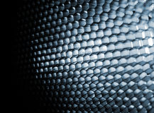 Steel honeycomb. Sing a honeycomb against white background Royalty Free Stock Image