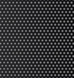 Steel honeycomb patterned dark background. Stock Photos