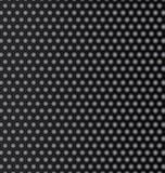 Steel honeycomb patterned dark background. Stock Photos