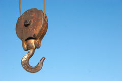 Steel Hook. A huge steel hook on a cable used on an old crane for constructing buildings and structures. This one is rated at 3 tons stock photo