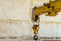 Steel hook of mobile crane. On industrial construction site Stock Images