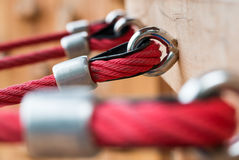 Steel hooks, red rope close-up Stock Photo