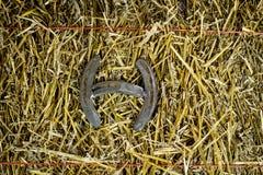 Letter H Steel Horseshoe on Straw stock photos