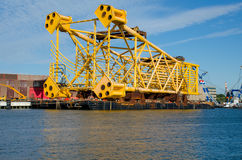 Steel jacket ready to be shipped in port of Rotterdam. A 7400t steel jacket prepared to be shipped for installation stock photography