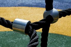 Steel joint with black ropes on a playground climbing equipment stock photos