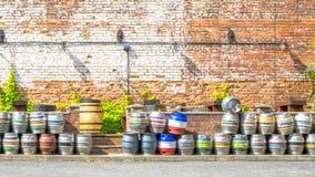 Steel kegs of beer in factory yard Stock Photos