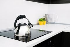 Steel kettle in modern kitchen Royalty Free Stock Photos
