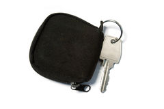 Steel key. And fabric trinket Royalty Free Stock Photos