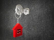 Steel key and red house Royalty Free Stock Image