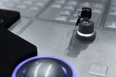 Steel keyboard and security lock key. Industrial control panel made of gray metal with blue trackball, keyboard and security lock key, close up photo with soft stock images