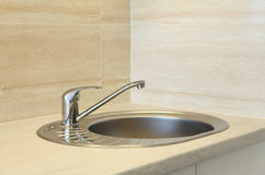 Steel kitchen faucet and sink stock image