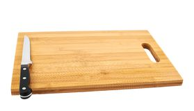 Steel kitchen knife on cutting board Stock Photo