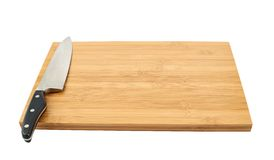 Steel kitchen knife on cutting board. Steel kitchen chef's knife on the wooden cutting board isolated over white background Royalty Free Stock Photos