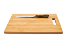 Steel kitchen knife on cutting board. Steel kitchen paring knife on the wooden cutting board isolated over white background Stock Photos