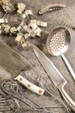 Steel kitchen utensils on a table. Steel kitchen utensils on a stone table royalty free stock images