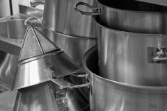 Steel kitchenware. Stacks of stainless steel kitchenware stock photo