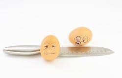 Steel knife breaks eggs Royalty Free Stock Photos