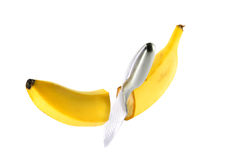 Steel knife cuts ripe banana Stock Photography