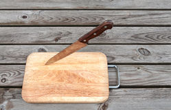 Steel knife and cutting board Royalty Free Stock Images