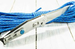 Steel knife with a mirror-shining blade. Back side. Paracord cord. Stock Image