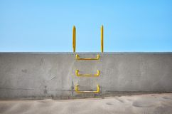Steel ladder embedded in a concrete wall. Conceptual picture stock images
