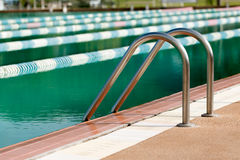 Steel ladder of swimming pool Stock Photos