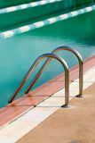 Steel ladder of swimming pool Royalty Free Stock Photography