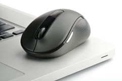 Steel laptop and black computer mouse Royalty Free Stock Image