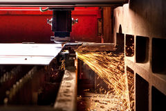 Steel laser cutting. Laser cutting of sheets of stainless steel plant Stock Photos
