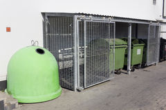 Steel lattices protect food  wast garbage. Tanks for food waste near a supermarket. Steel lattices protect containers from hungry beggars and bums Royalty Free Stock Photography