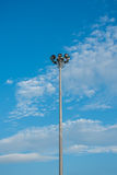 Steel light pole with sky. Clou Royalty Free Stock Photos