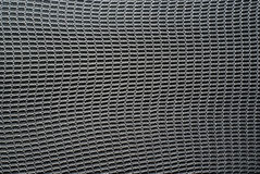 Steel-like Mesh Background Texture. Close-up detail of a steel-like woven mail texture or background royalty free stock photo