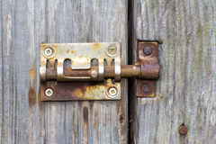 Steel lock of iron corroded by rust. Very old. Strong influence Royalty Free Stock Photo