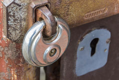 Steel lock on rusty gate Stock Images