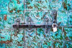 Steel lock on the rusty green metal door Stock Images