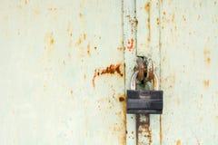 Steel lock on the rusty grey metal door. close-up. Stock Photo