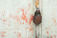 Steel lock on the rusty grey metal door. close-up. Royalty Free Stock Image