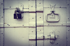 Steel lock on the rusty metal door Stock Photos
