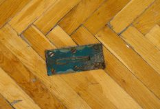 Steel locks for training equipment. Worn out wooden floor of sports hall Royalty Free Stock Photos