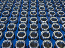 Steel machined parts. In a row ready for quality control Stock Photos