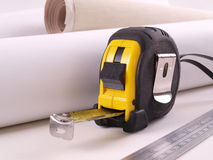 Steel Measuring Tape & Ruler with Paper Rolls. Some Tools at the Builders Site Office stock images