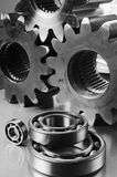 Steel-menagerie. Mechanical-components lying on brushed aluminum Royalty Free Stock Photos