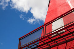 Steel mesh at balcony with red wall and blue sky Royalty Free Stock Photo